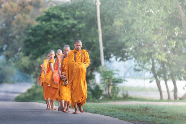 The monk walking for receive food at morning