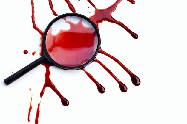 Magnifying glass with blood